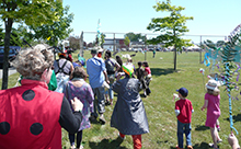 Community parade along the route of Bowker Creek during BCI Celebration