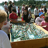 Kids enjoying the watershed model at Canada Day celebrations
